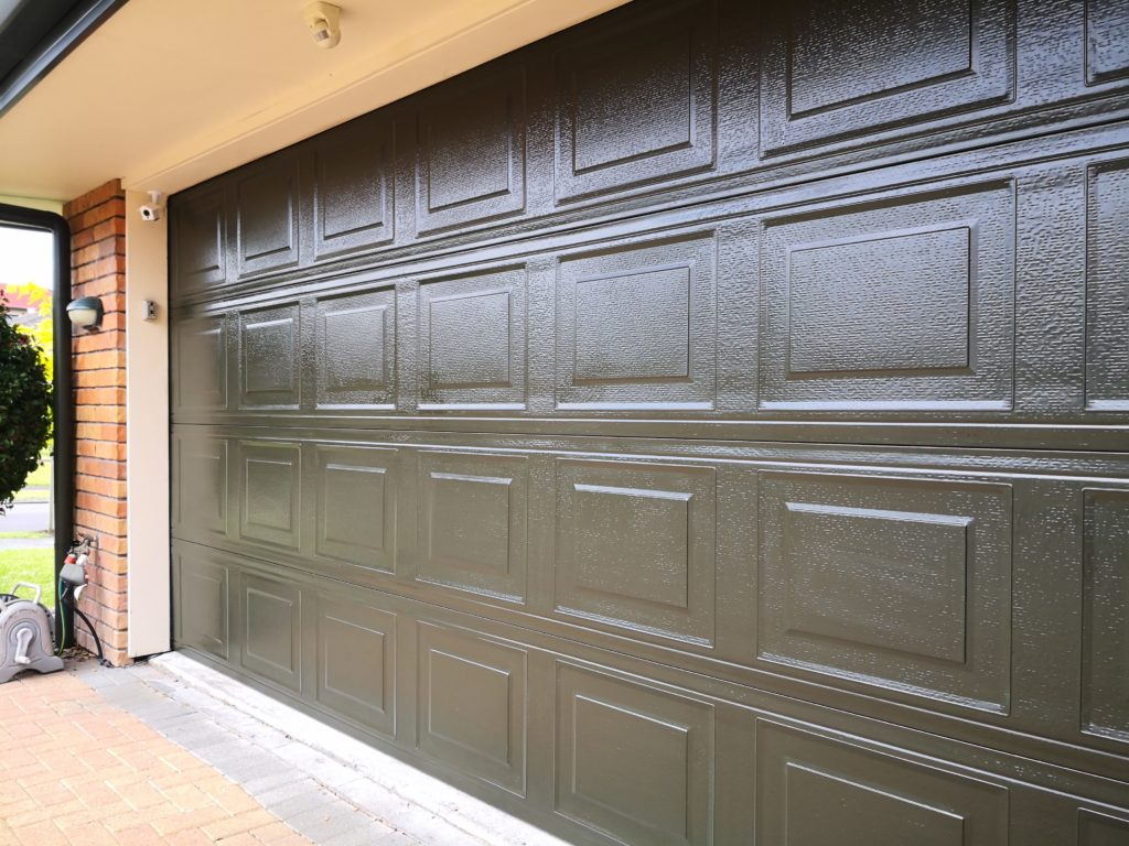 Restored and protected powder coated,garage door using an Everbrite DIY Coating