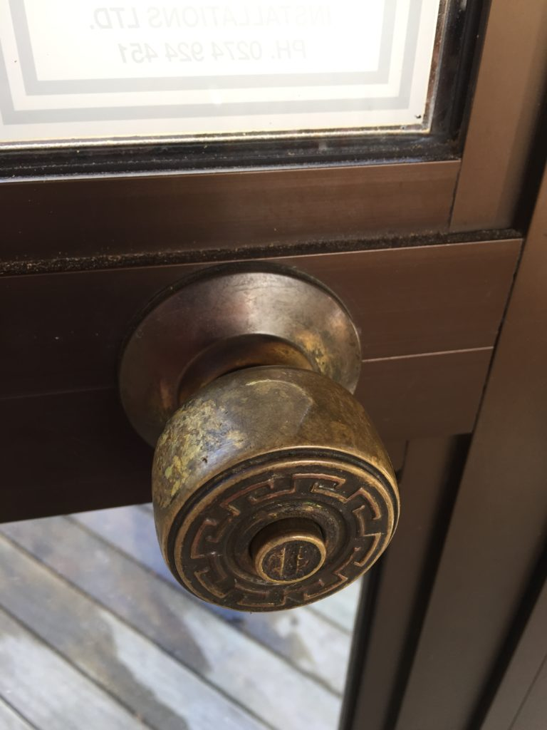 tarnished brass door handle could be restored and coated with ProtectaClearbefore