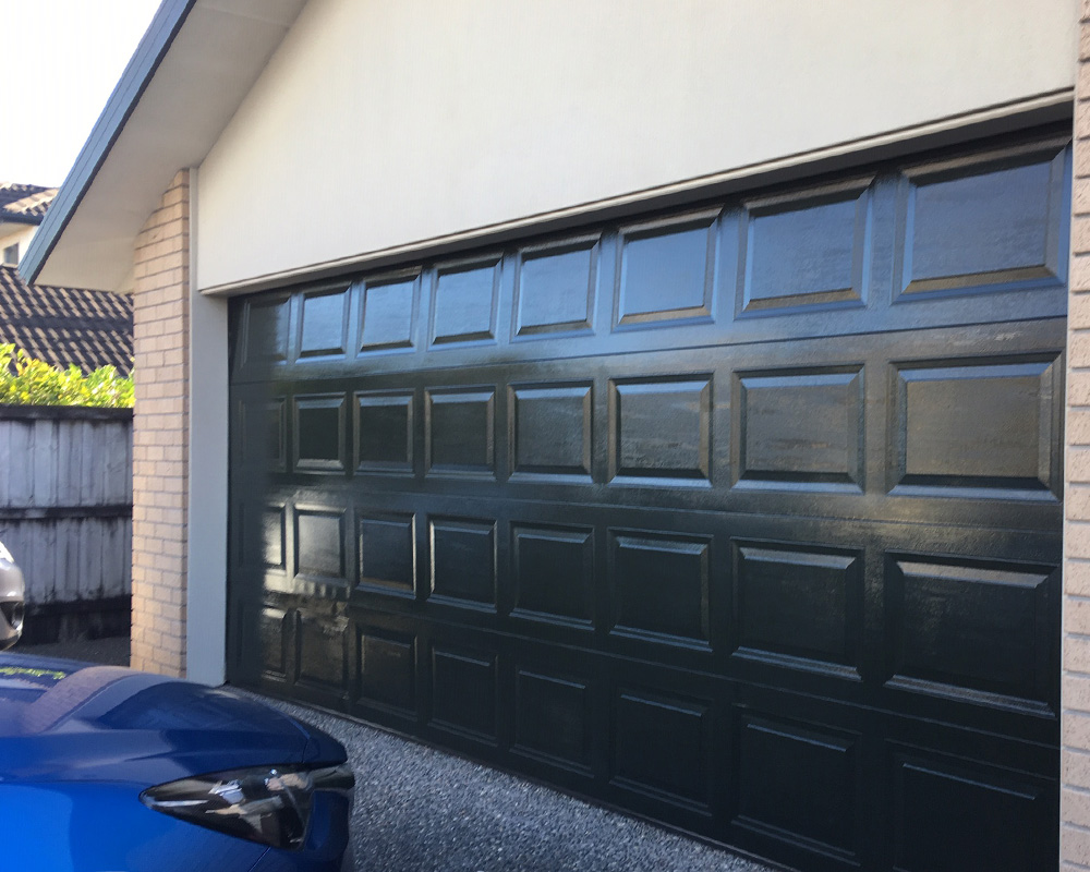 Everbrite Coating restored the colour and shine on this previously faded garage door