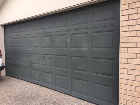Faded Garage door - before being restored with an Everbrite Coating