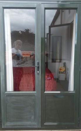 Customer photo of a restoration job on her French doors with an Everbrite Coating