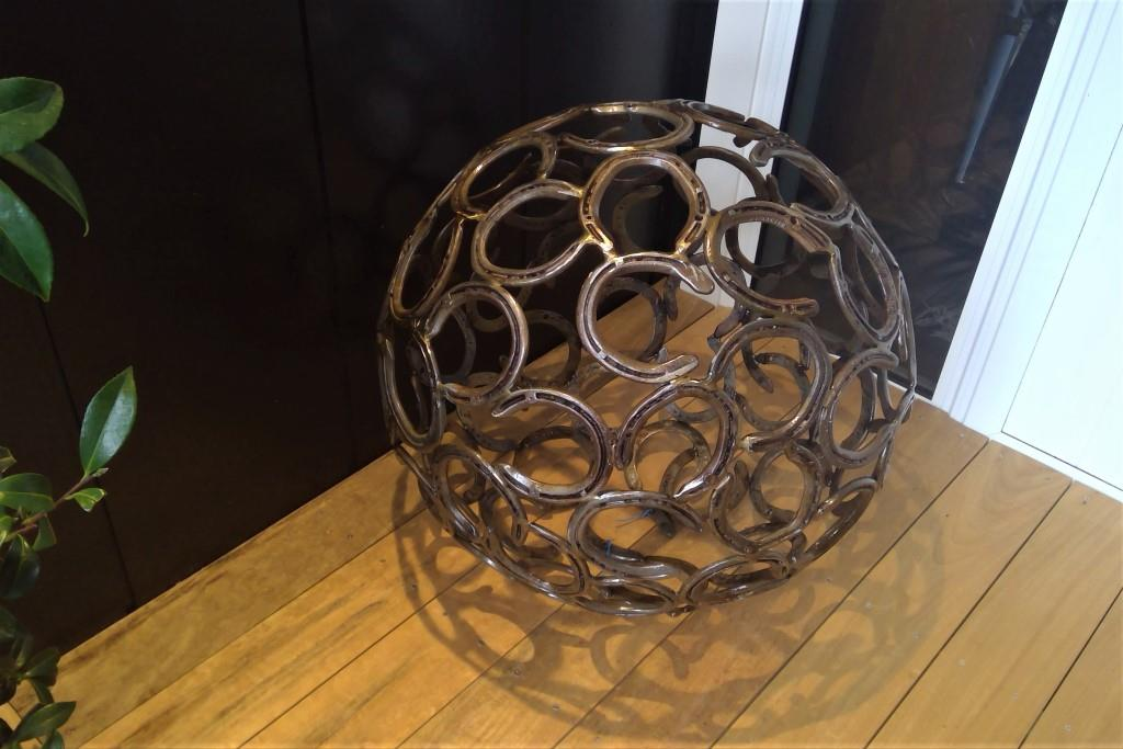 Rusted and mild steel artwork like this horseshoe globe are protected with Everbrite to stop staining and further corrosion.